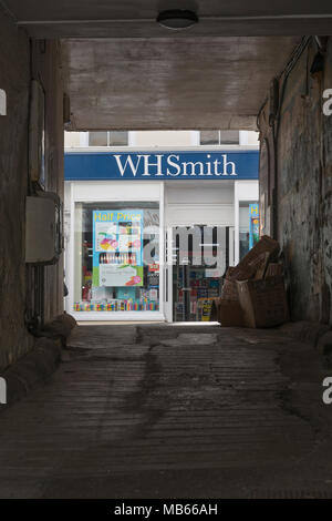 Death of the High Street metaphor / concept - WHSmith Bodmin (Cornwall) seen through archway opposite shop. High Street crisis, WH Smith rent cut plea - Stock Photo