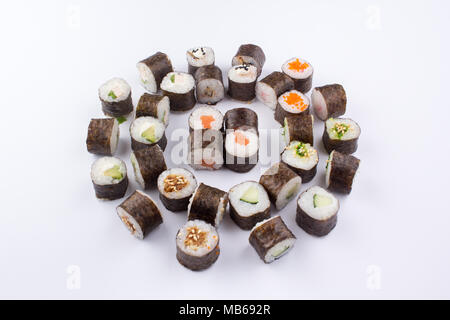 A set of sushi rolls laid out in an original way. - Stock Photo