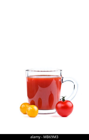 A glass of tomato juice and red and yellow tomatoes on white background. - Stock Photo