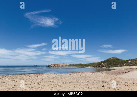Wisps of cloud against a clear blue sky above Penguin Island, Rockingham, Western Australia - Stock Photo