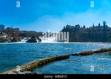 View of Rhine Falls the largest waterfalls in Europe located on the High Rhine on the border between the cantons of Schaffhausen and Zürich in Switze - Stock Photo