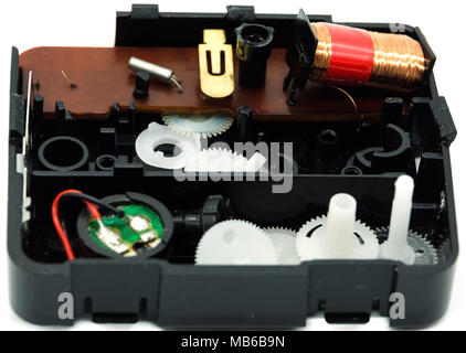 A box of clock parts after it was taken apart and containing the cog wheels. Ancient circuit board and resister. - Stock Photo