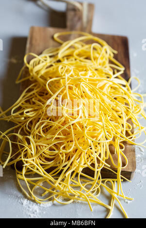 Raw tagliolini, type of italian pasta - Stock Photo