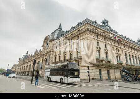 A large double decker bus waits for its signal outside the Musée dOrsay on the banks of the Seine River in Paris France - Stock Photo