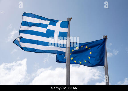 The Greek flag and the European Union flags flying together - Stock Photo