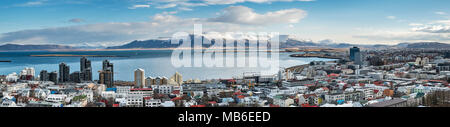 Reykjavik, Iceland. Panoramic view northeast from the tower of Hallgrimskirkja church, looking over the city to the hills above the bay of Hofsvik - Stock Photo