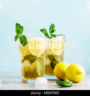 Traditional iced tea with lemon and ice in tall glasses - Stock Photo