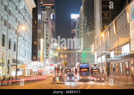 KOWLOON HONG KONG, SEPTEMBER 20, 2017;Light trails from passing vehicle and buses at Nathan and Salisbury Roads intersection in nighttime - Stock Photo