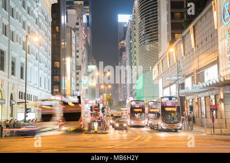 KOWLOON HONG KONG, SEPTEMBER 20, 2017;Night long exposure of passing vehicles on busy city street. - Stock Photo