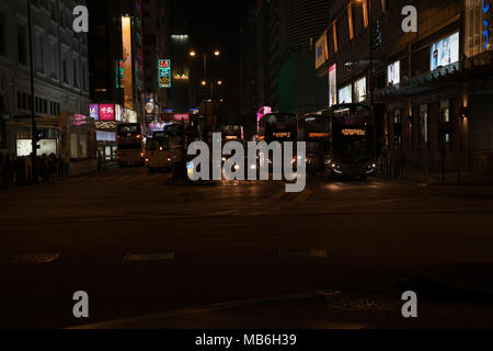 KOWLOON HONG KONG, SEPTEMBER 20, 2017; In dark of night city and vehicle lights on Nathan Road. - Stock Photo