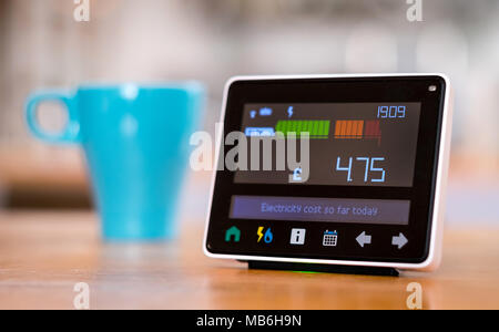 Energy monitor ( Smart Metre ) in the kitchen of a UK home - Stock Photo