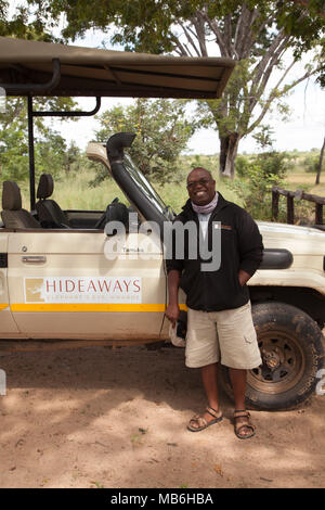 Staff member at the Elephant Eye Safari Lodge in Hwange National Park, Zimbabwe. The man leads game drives in the park. - Stock Photo