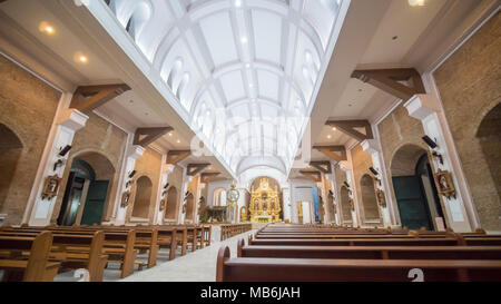 Interior inside the Catholic temple in the Philippines. Parishioners and tourists near the Christmas nativity scene. Prayers. Excursions. - Stock Photo