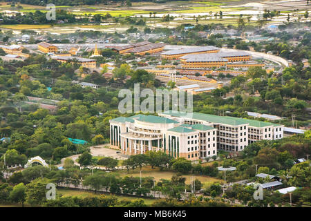 View of University of Traditional Medicine and prison from the top of Mandalay Hill, Mandalay, Myanmar. Mandalay is the second largest city in Myanmar - Stock Photo