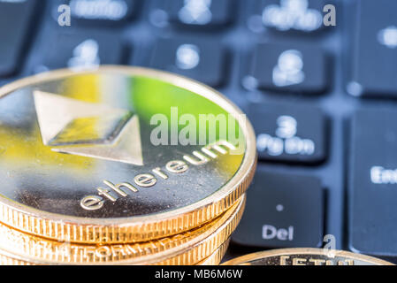 Ethereum coin symbol on laptop, future concept financial currency, crypto currency sign. - Stock Photo