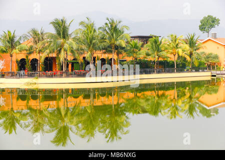 Village beside River, it is Thai local community life. a group of houses and associated buildings, smaller town. - Stock Photo