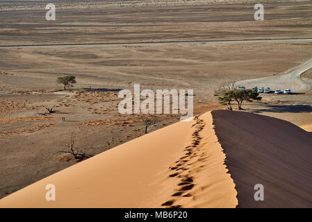 view from dune 45 into valley, desert landscape of Namib - Stock Photo