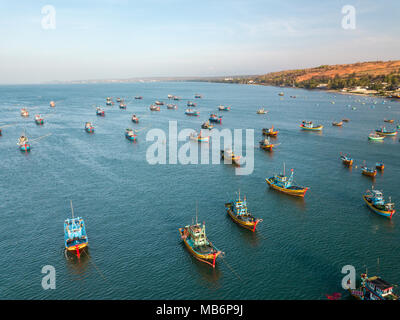 Top view. Aerial view fishing harbour from drone. Royalty high quality free stock image of basket boat at Mui Ne fishing harbour or fishing village - Stock Photo