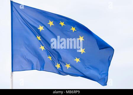 European Union (EU) flag flying in the wind. - Stock Photo