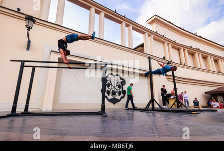Uzhgorod, Ukraine - Jun 10, 2016: participants of outdoor sports competition. workout championship in Uzhgorod. Young men show their skill on the aren - Stock Photo