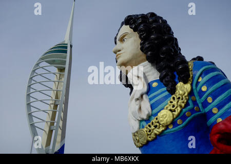 Old ship's figurehead from HMS Marlborough at Gunwharf Quays and Emirates Spinnaker Tower, Portsmouth, Hampshire, England, UK - Stock Photo