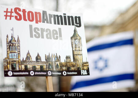 Protest sign against Israel and Israeli Flag - Stock Photo