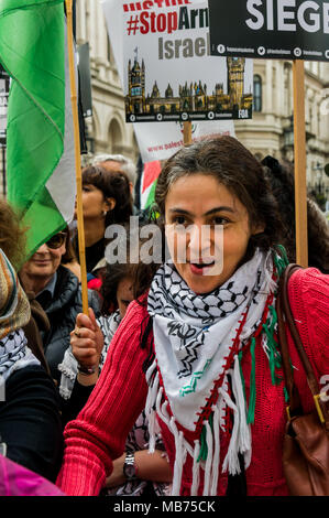 April 7, 2018 - London, UK. 7th April 2018. A protest at Downing St comdemns the shooting by Israeli snipers of peaceful unarmed Palestinian protesters on the first day of a peaceful protest, the Great March of Return, at the separation wall in Gaza on Land Day, 30th March. Live fire by the Israelis killed 17 and wounded over 750. A further nine Palestinians including one journalist were killed yesterday and 1,350 injured, around 400 by live fire, with around 25 in a critical condition. There were many speeches condemning the Israeli shootings, calling for an end to the siege of Gaza and for - Stock Photo