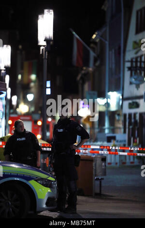 Muenster, Germany. 7th Apr, 2018. Police officers stand guard at the site of the vehicle plowing in Muenster, Germany, on April 7, 2018. Three people including the perpetrator died and a dozen more injured, after a van plowed into crowd in the old town of western German city of Muenster, interior minister of State North Rhine-Westphalia Herbert Reul told media Saturday night. Credit: Luo Huanhuan/Xinhua/Alamy Live News - Stock Photo