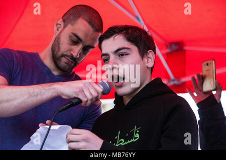 London, UK. 7th April, 2018. Rapper Lowkey joins two children to read the names of Palestinians killed by Israeli snipers at the Great March of Return in Gaza at the end of a rally attended by hundreds of people outside Downing Street. Credit: Mark Kerrison/Alamy Live News - Stock Photo