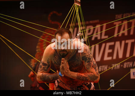 Kathmandu, Nepal. 8th Apr, 2018. A man gestures while performing a body suspension during the International tattoo convention in Kathmandu, Nepal on Sunday, April 08, 2018. Credit: Skanda Gautam/ZUMA Wire/Alamy Live News - Stock Photo