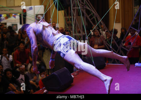 Kathmandu, Nepal. 8th Apr, 2018. A man performs a body suspension during the International tattoo convention in Kathmandu, Nepal on Sunday, April 08, 2018. Credit: Skanda Gautam/ZUMA Wire/Alamy Live News - Stock Photo