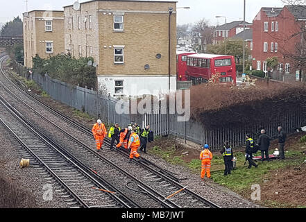 Tooting, South London, UK. 8th April, 2018. Body taken off railway line, Tooting, South London Credit: London Snapper/Alamy Live News - Stock Photo