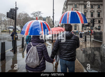 London, UK. 8th April, 2018. UK Weather: Union flag umbrellas on a wet and rainy Sunday afternoon in Westminster. Credit: Guy Corbishley/Alamy Live News - Stock Photo