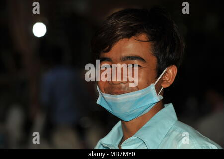 Phnom Penh, Cambodia. 8th April, 2018. Cambodia celebrates Khmer New Year, Portrait of a Khmer man wearing a face mask & working as a cook, Phnom Penh, Cambodia, Credit: Kraig Lieb / Alamy Live News - Stock Photo