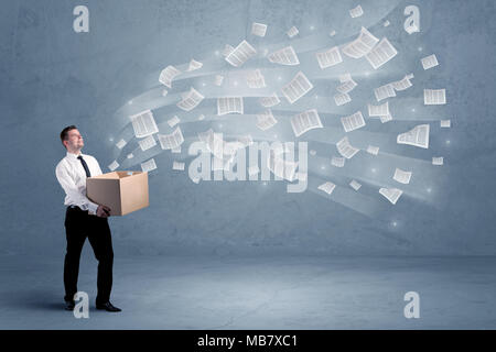 Office documents, contracts, papers flying out of cardboard box being held by a young business worker concept. - Stock Photo