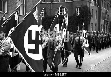 Sturmabteilung also called stormtoopers and Brownshirts carrying Swastika Flags in 1934 as they parade through Konigsberg in Germany. Konigsberg became Russian territory after the second world war and was renamed Kaliningrad. - Stock Photo