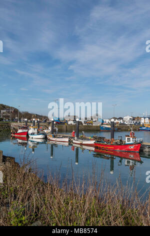 Colorful fishing boats in harbor - Stock Photo