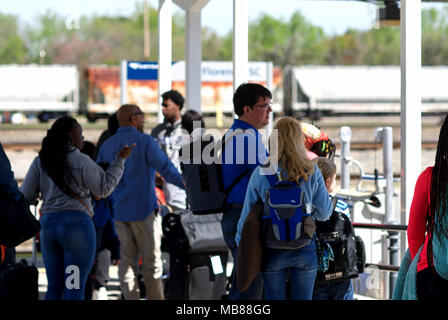 Florence, South Carolina, USA - April 2, 2018: Passengers prepare to board Amtrak's 'Palmetto', train #90 heading North at the Florence, SC, station. - Stock Photo