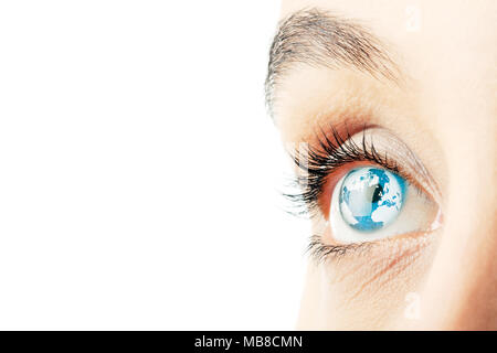 Close up of woman's eyes with world map superimposed - Stock Photo