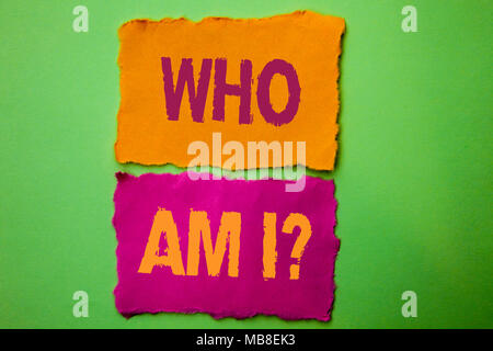 Handwriting text Who Am I Question. Concept meaning Question Asked Identity Thinking Doubt Psycology Mystery written on Tear Papers on the Green background. - Stock Photo