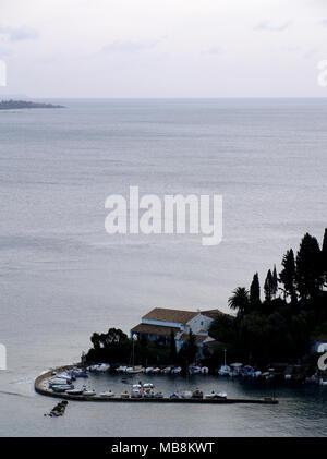View of Kaloura Harbour, Corfu, Greece on winters day - Stock Photo