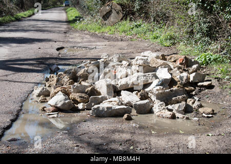 Fly-tipping in the leafy lanes of Buckinghamshire.. - Stock Photo