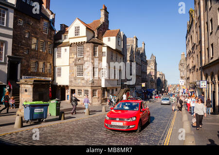 EDINBURGH, UK - AUG 8, 2012: Tourists at Royal Mile, a popular tourist attraction and the busiest tourist street in the Old Town - Stock Photo
