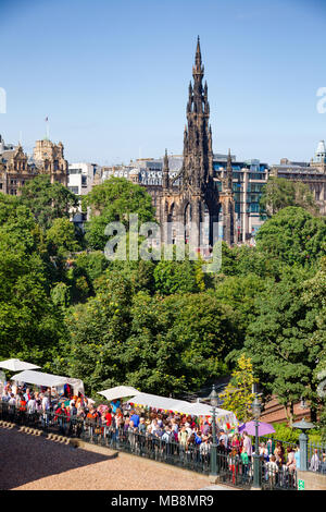 EDINBURGH, UK - AUG 8, 2012: Busy walkway to the Playfair Steps during the Fringe Festival. The Walter Scott Monument is seen in  background - Stock Photo
