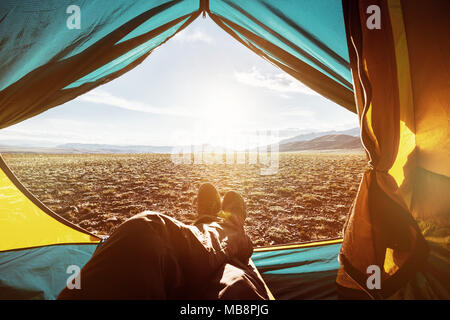 Man's legs tourist having rest tent view inside - Stock Photo