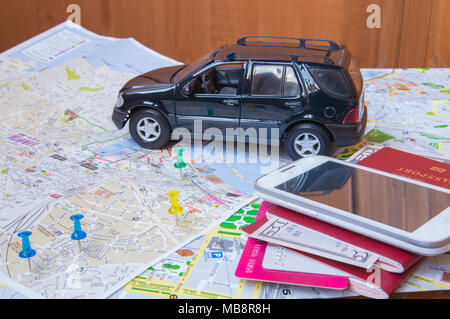 Plan your journey by car, a passport, money, cards, mobile phone - Stock Photo