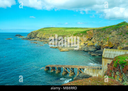 A boat house and slipway in a small bay at Lizard Point in Cornwall, the most southerly part of the British Isles - Stock Photo