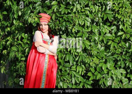 Slav in traditional dress ivy wall tree - Stock Photo