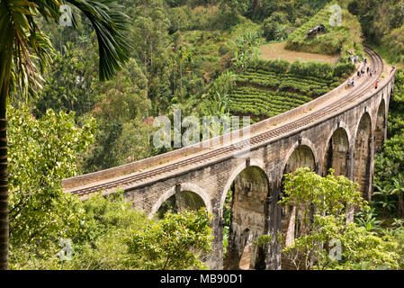 Horizontal view of people on the tracks at Nine Arches Bridge near Ella, Sri Lanka. - Stock Photo