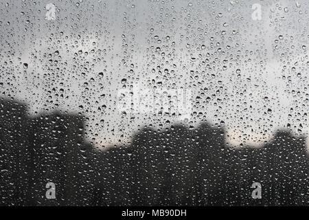 Strong rain drummed on the windowpane - Stock Photo
